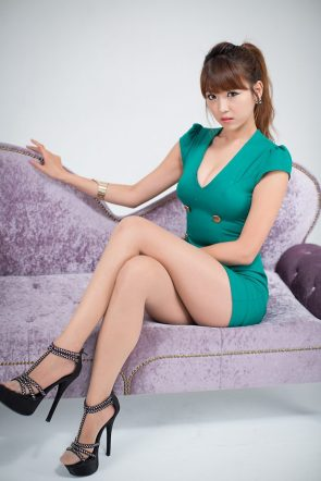 Asian in green Dress on Purple couch
