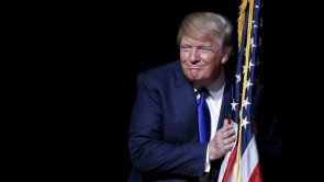 donald trump rubbing the united states of ameria's flag