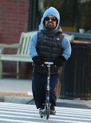 Dinklage on a scooter