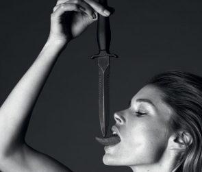 Doutzen Kroes licking a knife