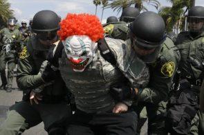Orange County Sheriff's deputies take a protester into custody