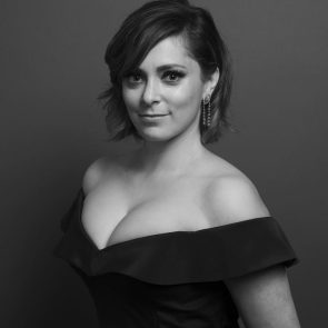 Rachel Bloom in a classy low cut black dress