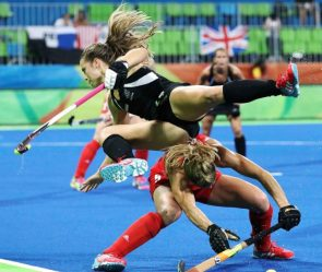 Rose Keddell of New Zealand (top) stumbles over Crista Cullen of Great Britain