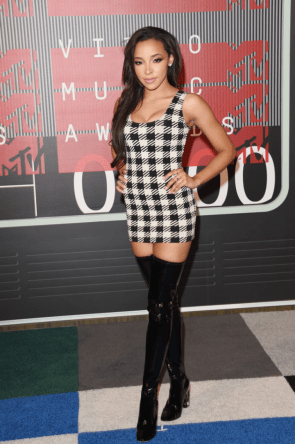 Tinashe in black boots and short dress