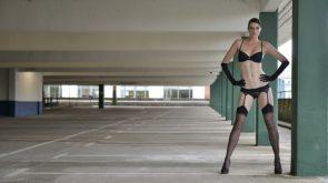 black undies in a parking garage