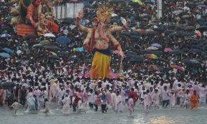 Devotees prepare to immerse an idol of elephant-headed Hindu god Ganesha in the Arabian Sea