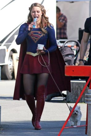 Melissa Benoist eating an icy and walking her dog