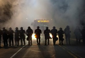 Police officers wearing riot gear in Charlotte, NC