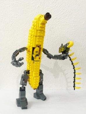 banana man in banana mech shooting a banana gun