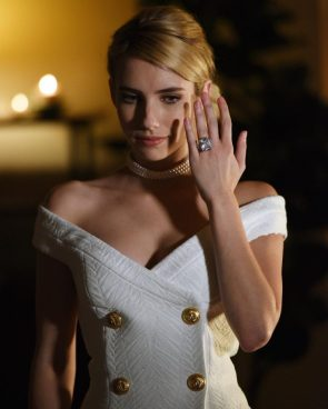Emma Roberts with a large rock