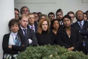 Obama's staff looking on while he gave his Election Response