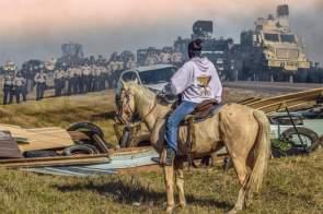 Protestor on a horse vs Military.jpg