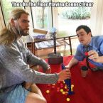 thor on the floor playing connect four