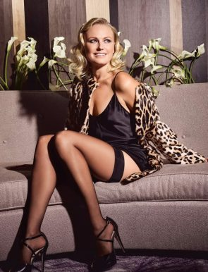 Malin Akerman in stockings on a couch