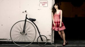 zooey has an old timey bike
