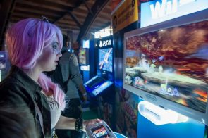 Pink haired woman at the arcade