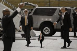 tiny trump being escorted from his big car