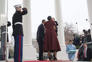 tiny trump hoisted up to kiss Michelle Obama