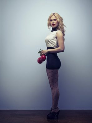 Anna Paquin holding red balls