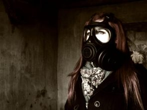 sexy red head in gas mask