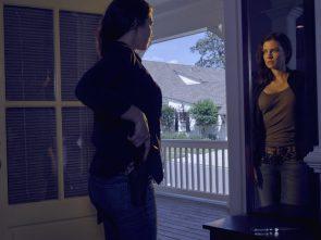 Lauren Cohan pulling her gun