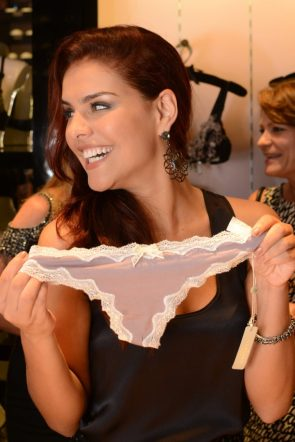 Paloma Bernardi holding her panties up to be photographed