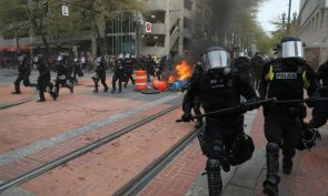 Police disperse people participating in a May Day rally in downtown Portland