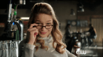 Supergirl looking over her glasses