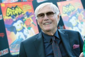 Adam West in black suit