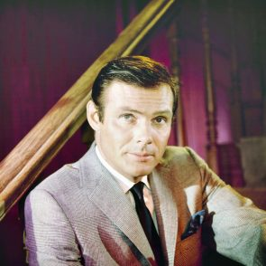 Adam West on the stairs
