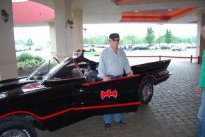 Adam West opening the batmobile's door