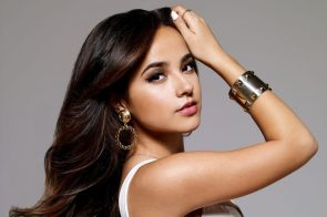 Becky G flexing her arm