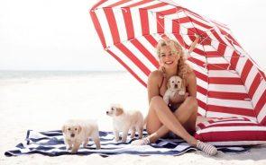 Margot Robbie with beach puppies