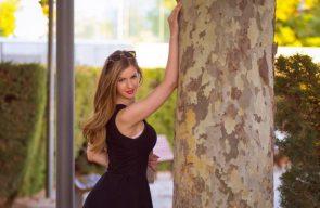 Stella Cox holding up a tree