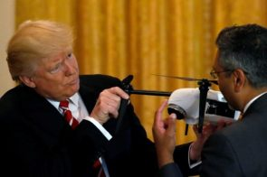 Trump inspecting a drone