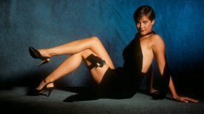 Carey Lowell carrying a small gun