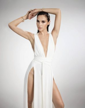 Gal Gadot showing off her hips in a white dress