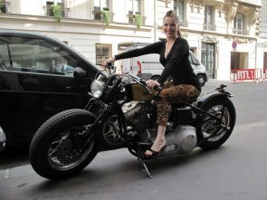 Imelda May on motorcycle while wearing inappropriate shoes