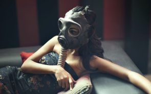 a woman in a gas mask
