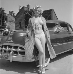 Marilyn Monroe in a bikini by a nice car