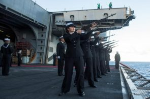 Sailors aboard the USS Ronald Reagan CVN 76 render a 21 gun salute during burial at sea of WWII veteran Julius Harry Frey July 15 2017
