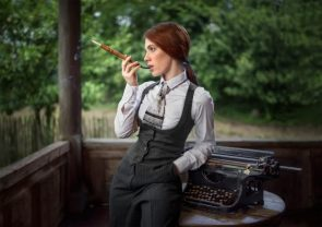 Dapper Young Woman Smoking Through A Device