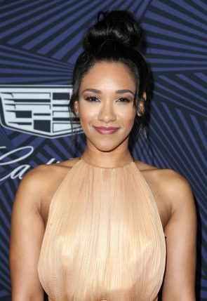 Candice Patton in a golden dress