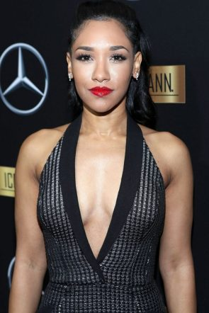 Candice Patton in low cut black dress