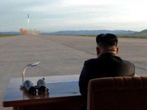 Kim Jongun watching the rocket take off