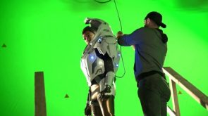 Sonequa MartinGreen in EV suit on large green screen stage
