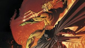 Aquaman and Batman fighting in the smoke and flame