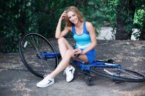a woman struggling to use a bike.jpg