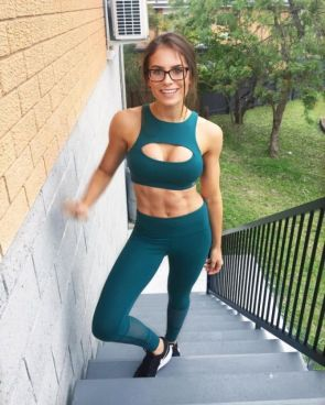 Cutie in glasses and rock hard abs on stairs