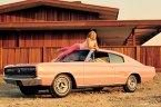 Allison Parks on a pink car
